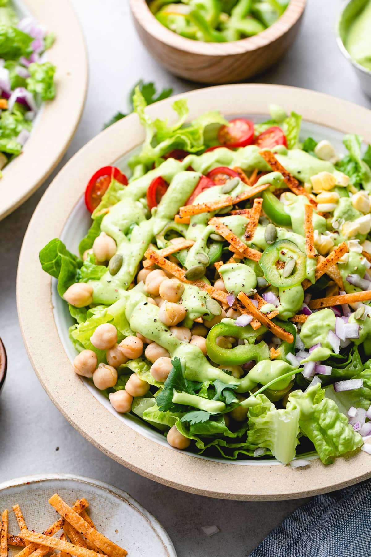 side angle view of southwestern chickpea salad with avocado dressing.