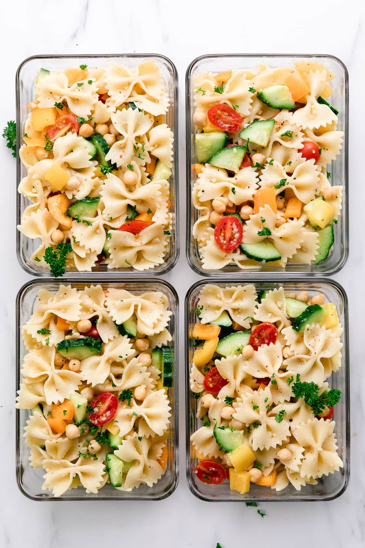 top down view of meal prepped vegetable pasta in glass containers.