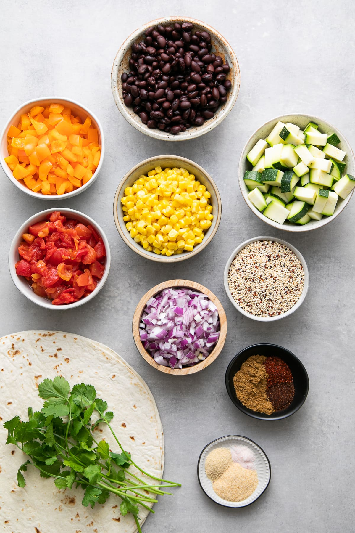 top down view of ingredients used to make black bean quinoa burritos.