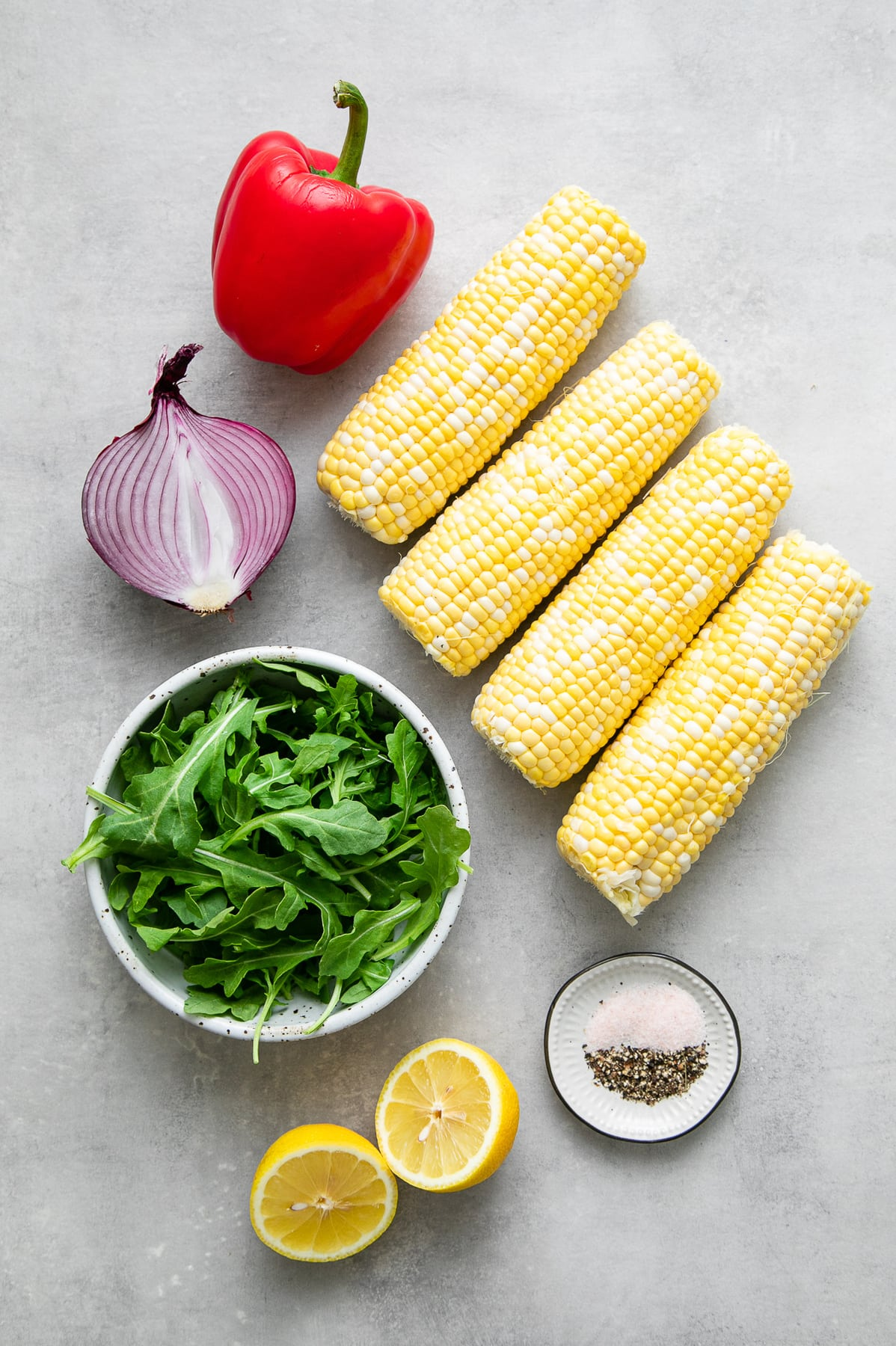 top down view of ingredients used to make easy corn arugula salad.