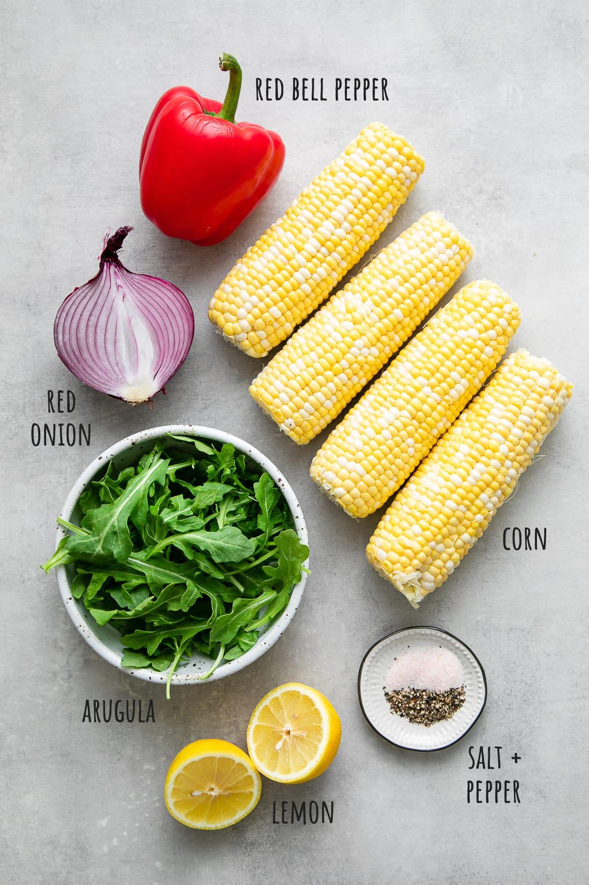 top down view of ingredients used to make corn arugula salad recipe.