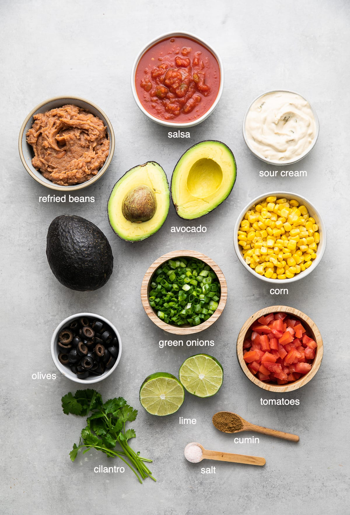 top down view of ingredients used to make vegan seven layer dip recipe.