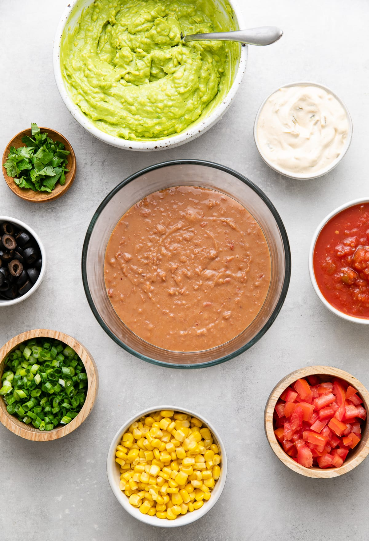 top down view of prepped ingredients ready to make vegan seven layer dip.