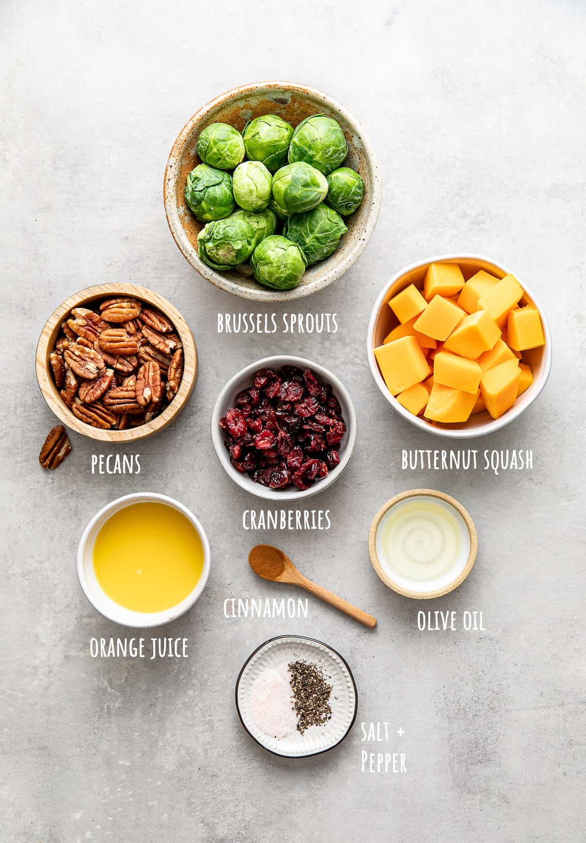 top down view of ingredients used to make vegan roasted brussles sprouts and butternut squash with cranberries and pecans.