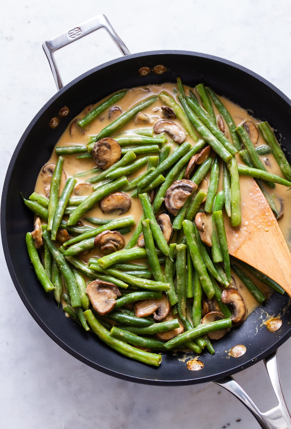 top down view of healthy vegan green bean casserole just finished cooking in a skillet.