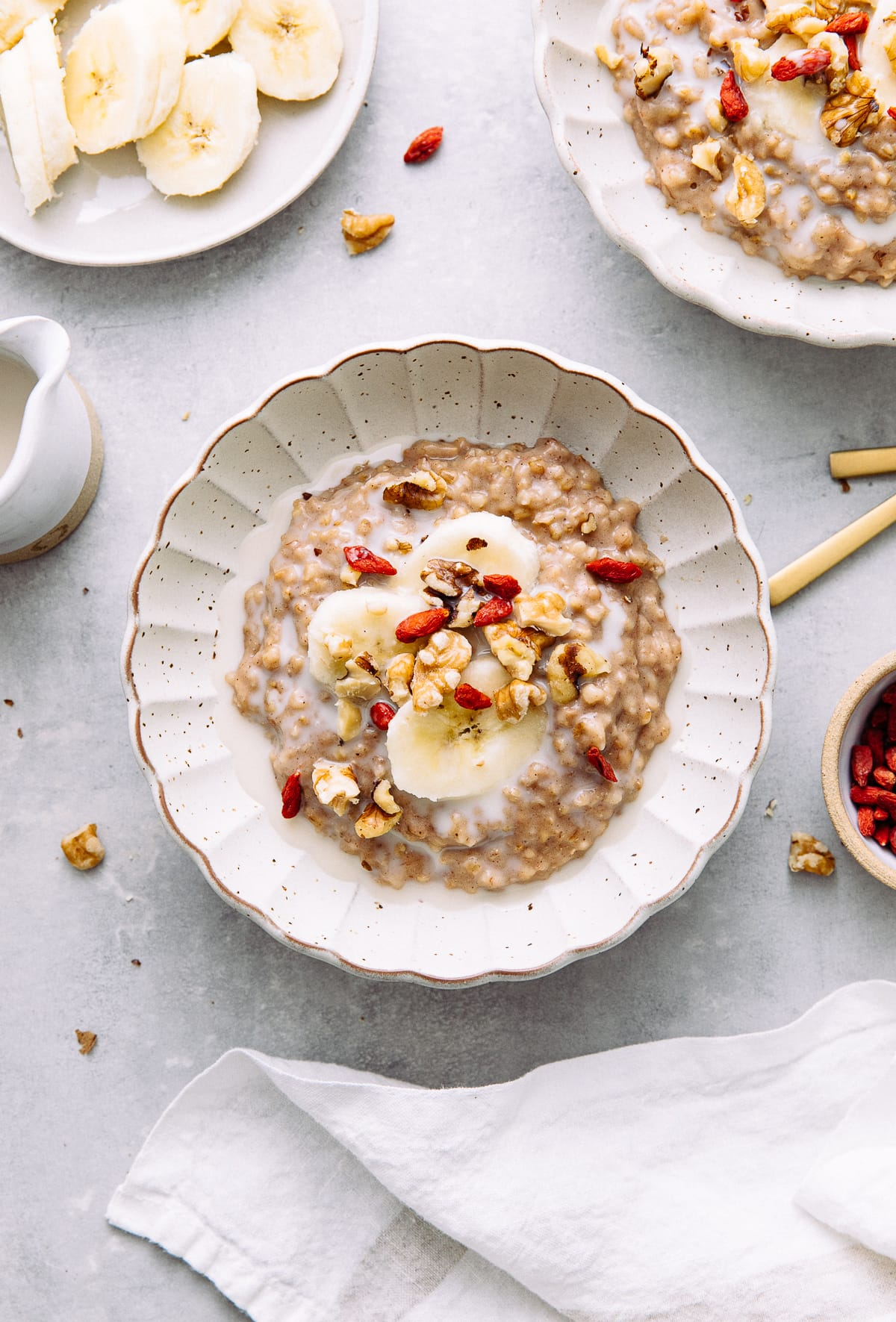 top down view of bowl with banana overnight steel cut oats with items surrounding.