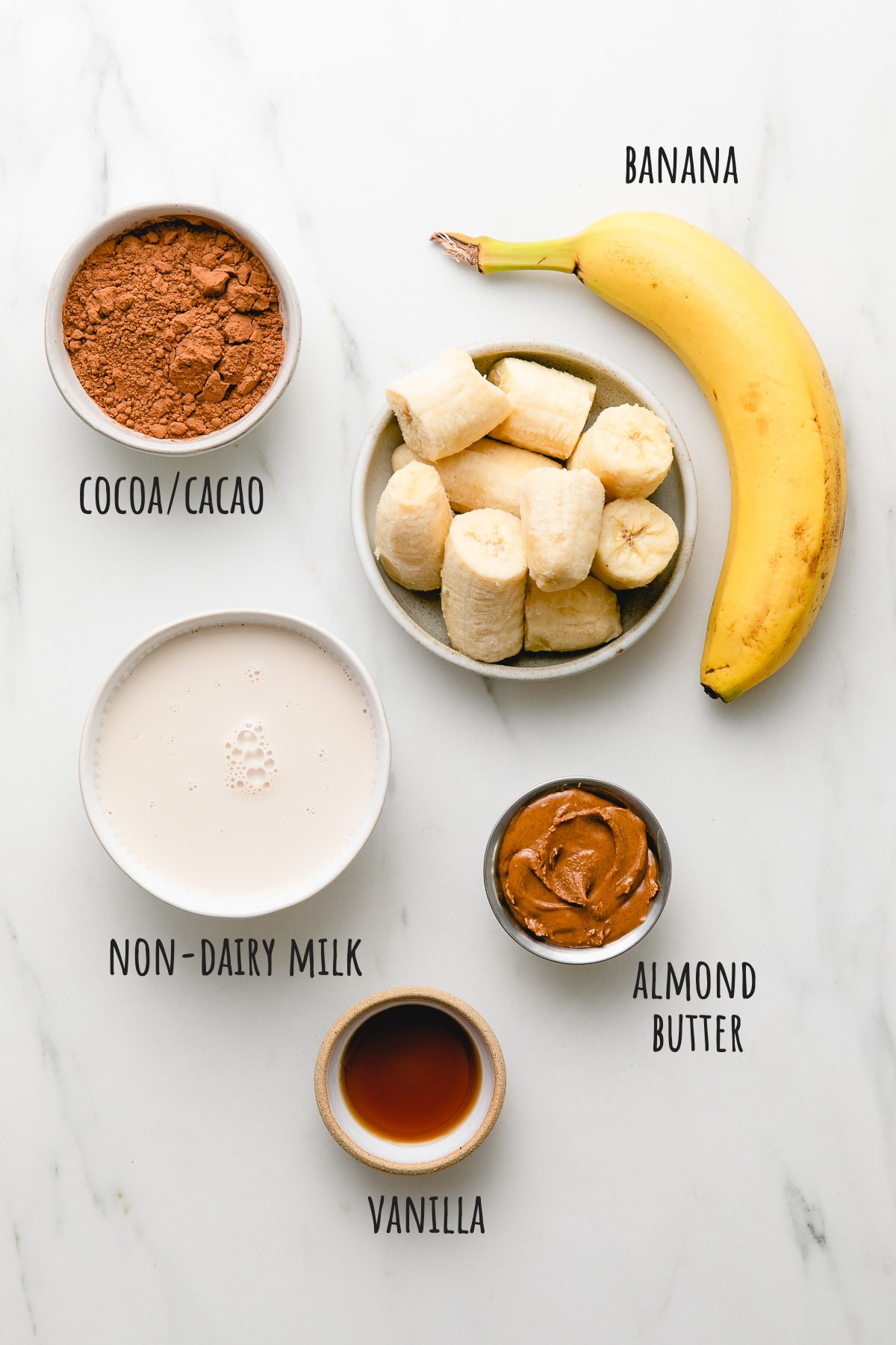 top down view of ingredients used to make chocolate almond butter smoothie bowl.
