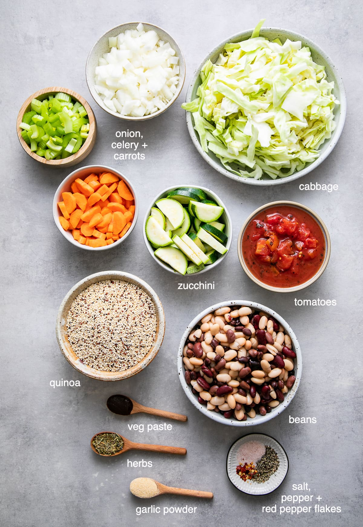 top down view of ingredients used to make healthy vegetable quinoa soup recipe.