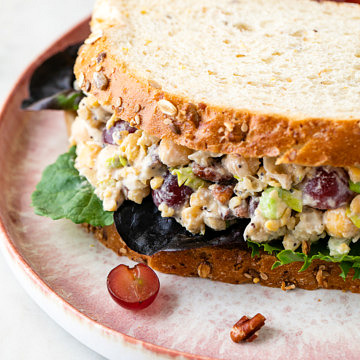 side angle view of Sonoma chickpea chicken sandwich on a plate.