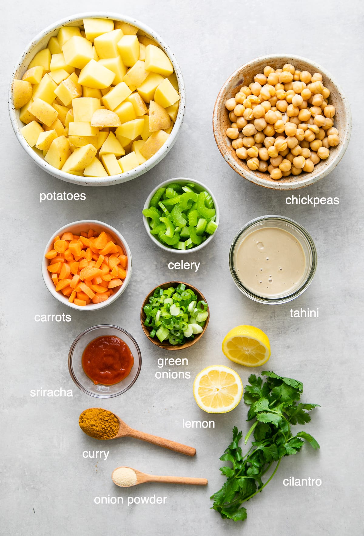 top down view of ingredients used to make curried potato salad recipe.