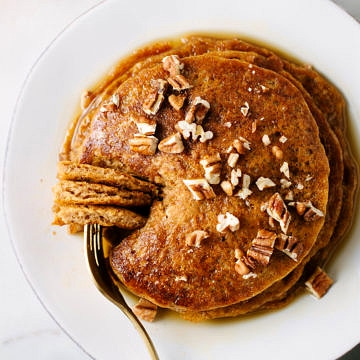 top down view of best vegan pumpkin pancakes on a plate with fork.
