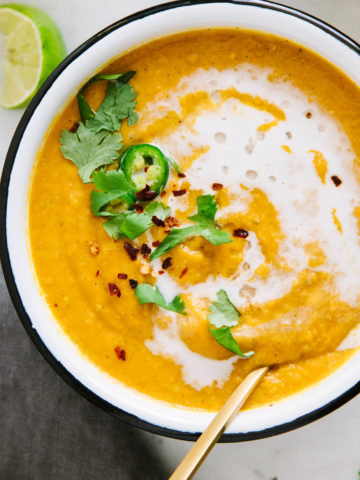 top down view of bowl of golden curry sweet potato red lentil soup.