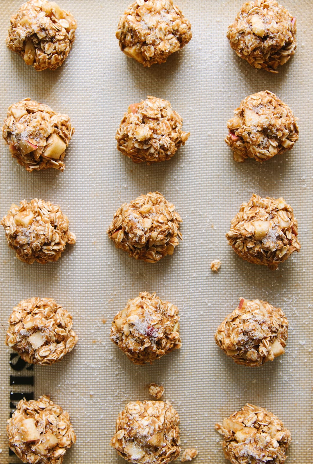 top down view of apple oatmeal breakfast cookies on a baking sheet ready for the oven.