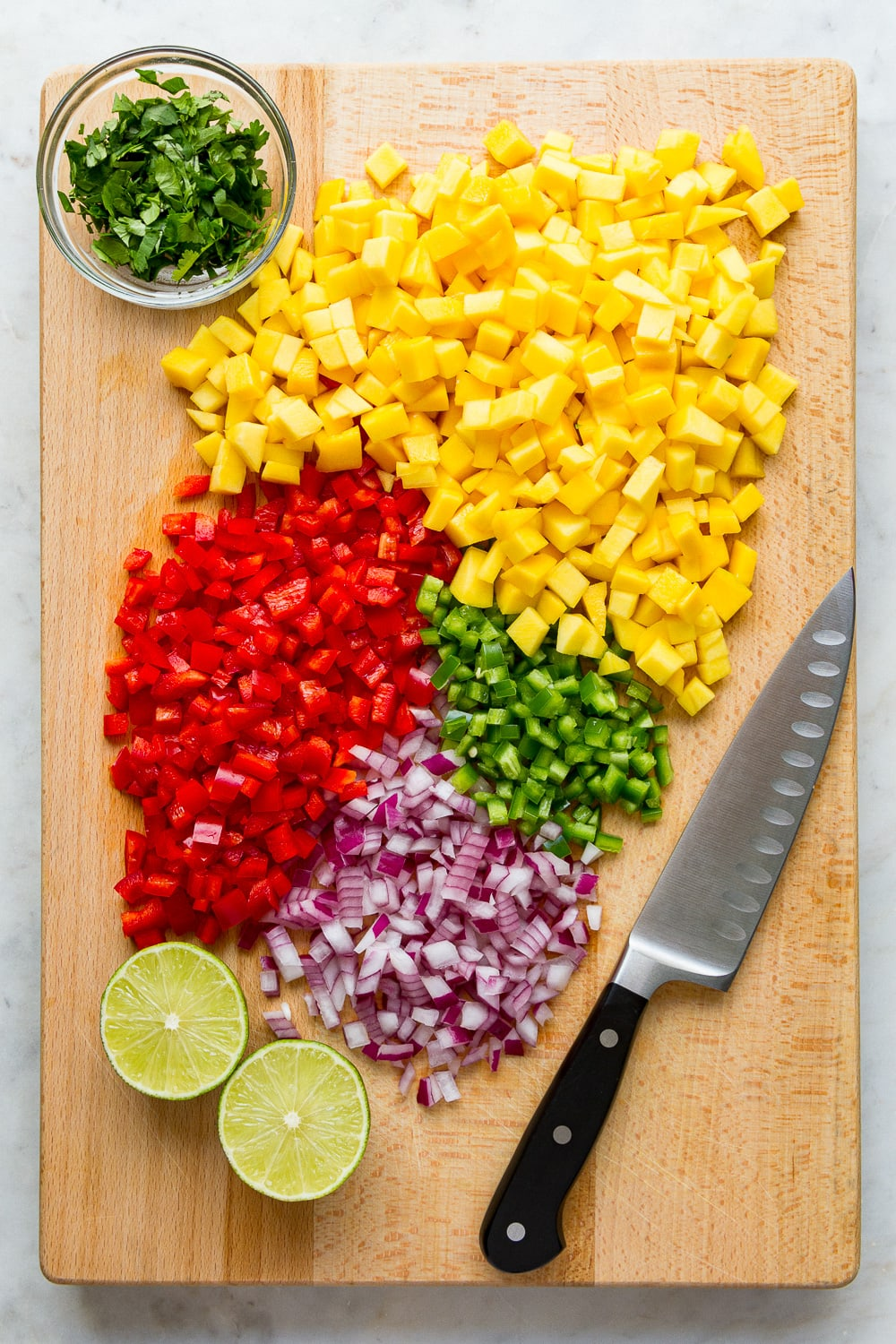 top down view of prepped ingredients needed to make mango salsa.