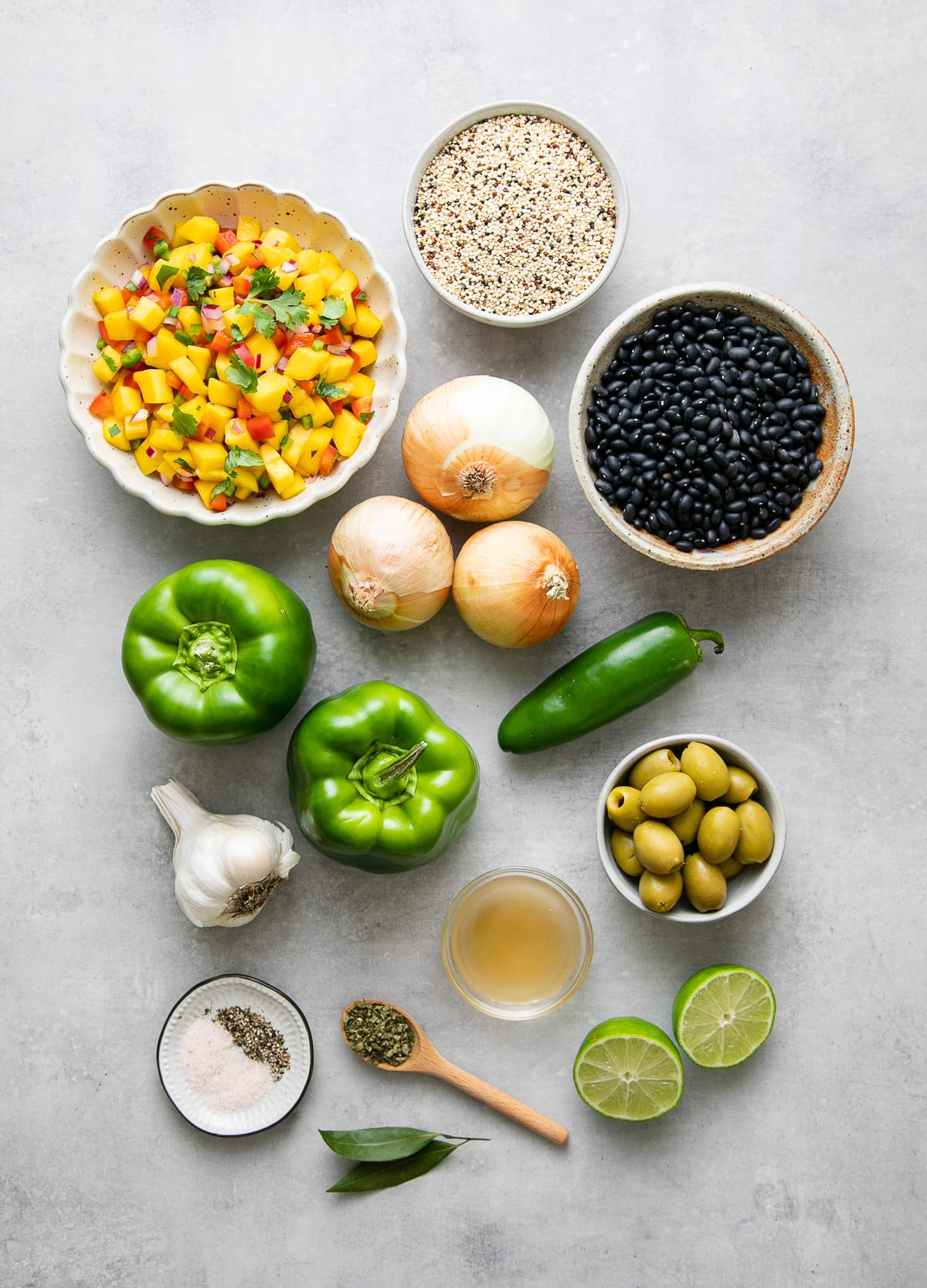 top down view of ingredients used to make cuban black beans with quinoa and mango salsa.