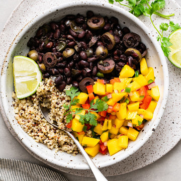 top down view of bowl with serving of healthy cuban black bean mango bowl with quinoa.