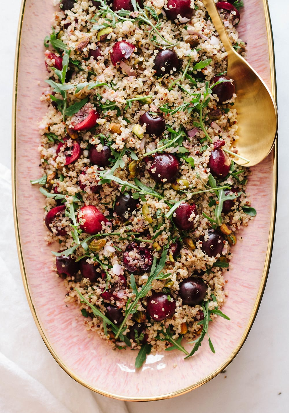 top down view of cherry mint pistachio quinoa salad