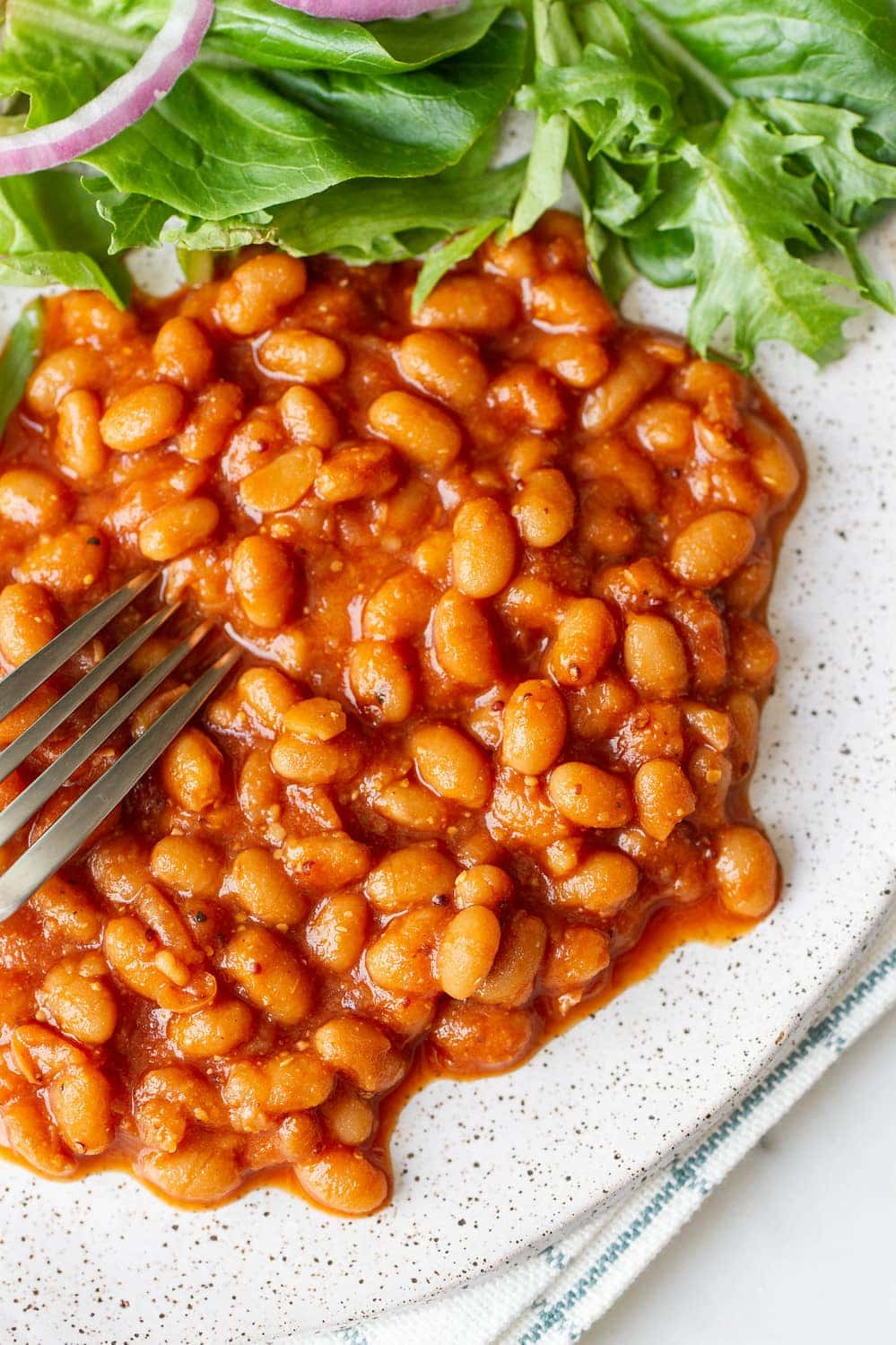 baked beans on a plate with fork