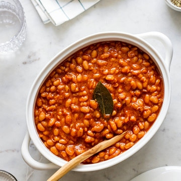 healthy baked beans in a white oval serving dish