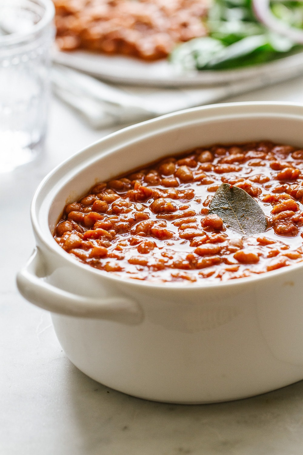 side angle view of healthy baked beans in a serving dish.