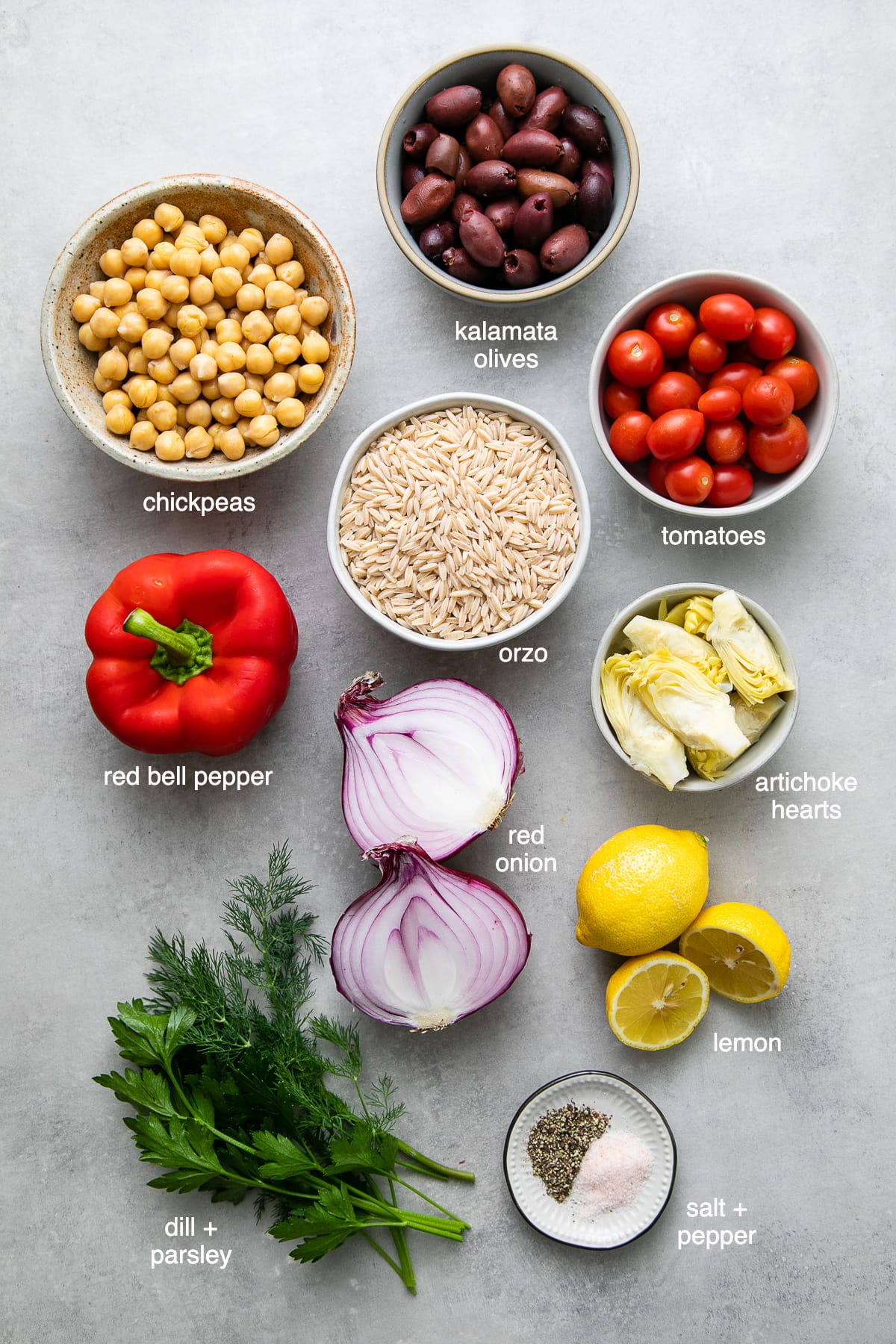 top down view of ingredients used to make healthy vegan Mediterranean orzo salad.