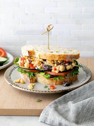 head on view of mashed Mediterranean chickpea salad sandwich.