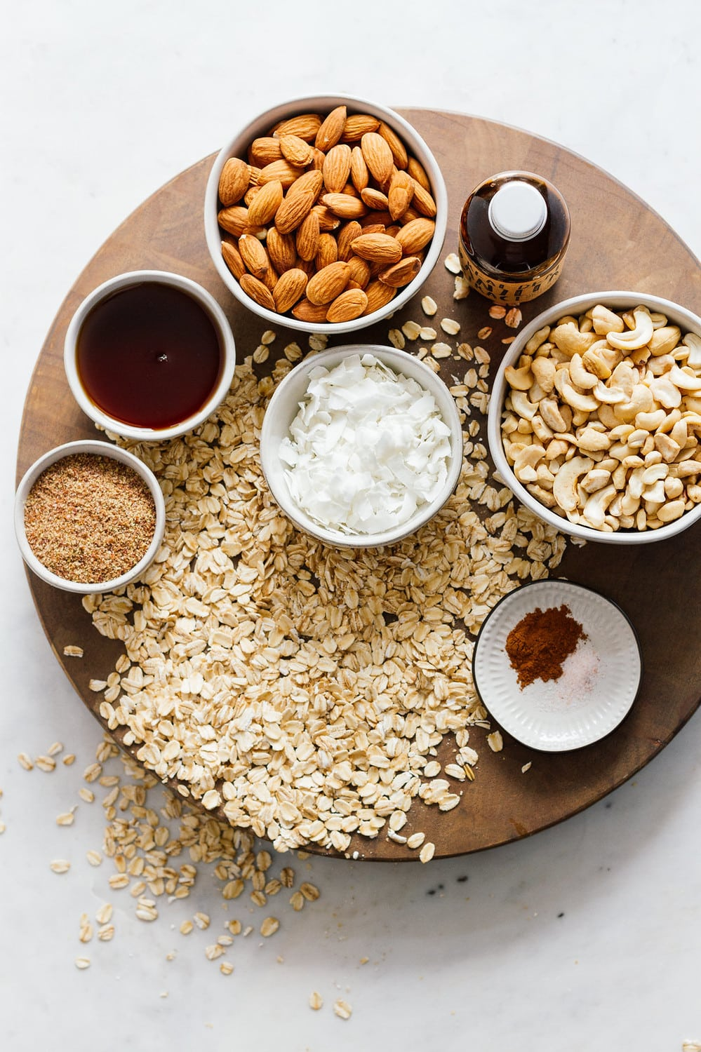 ingredients for granola on a wooden board