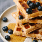 easy 5 ingredient vegan waffles with maple syrup and blueberries