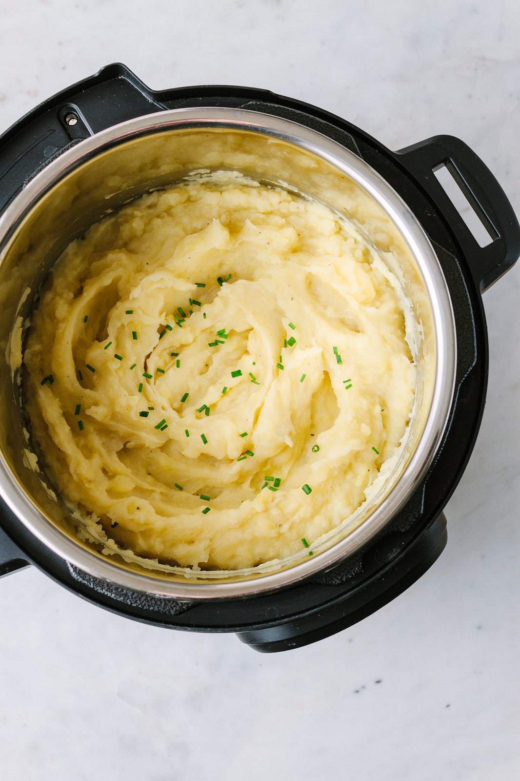 top down view of finished vegan mashed potatoes made in an instant pot.