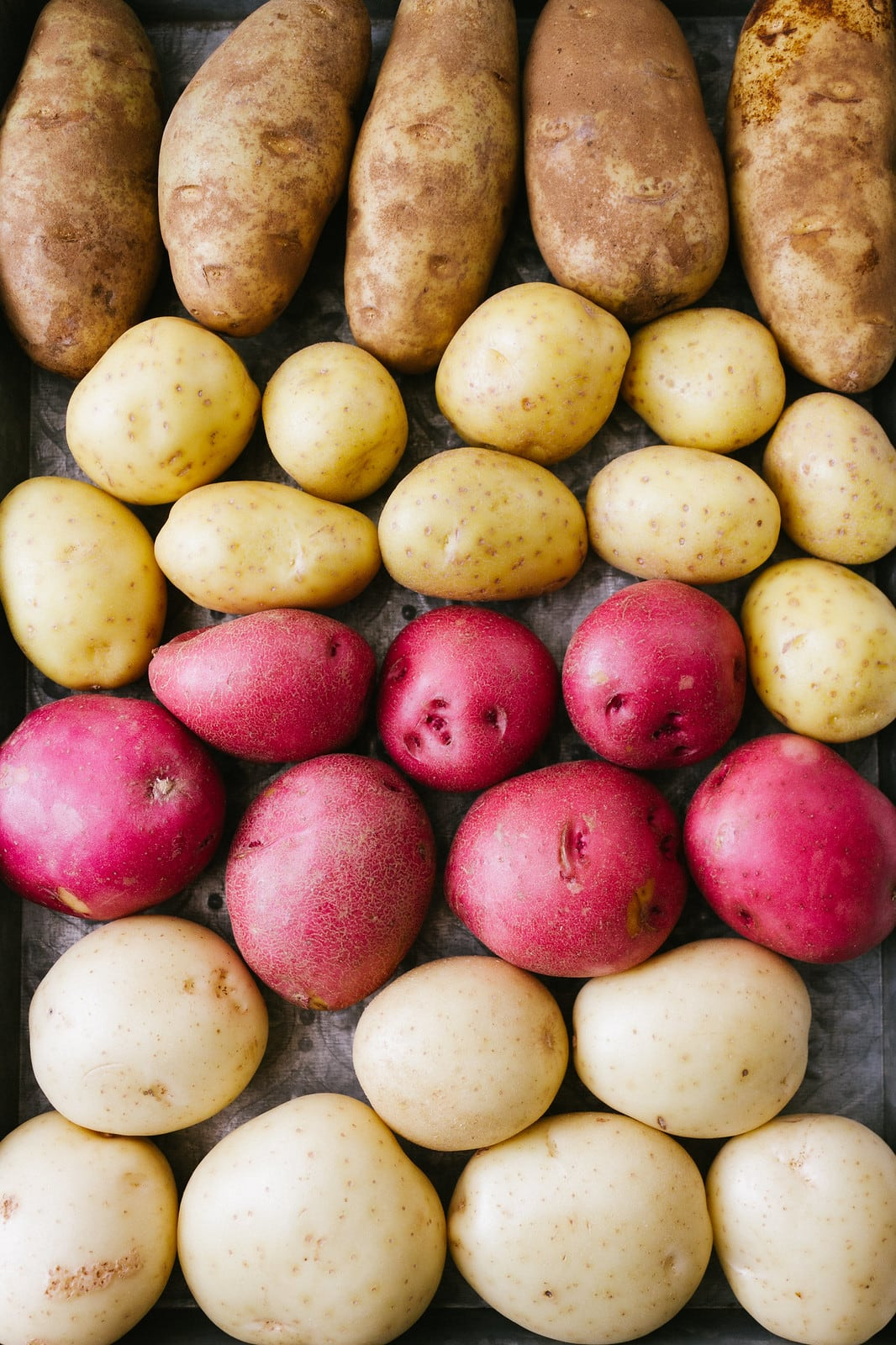 top down view of different types of potatoes for making vegan mashed potatoes.