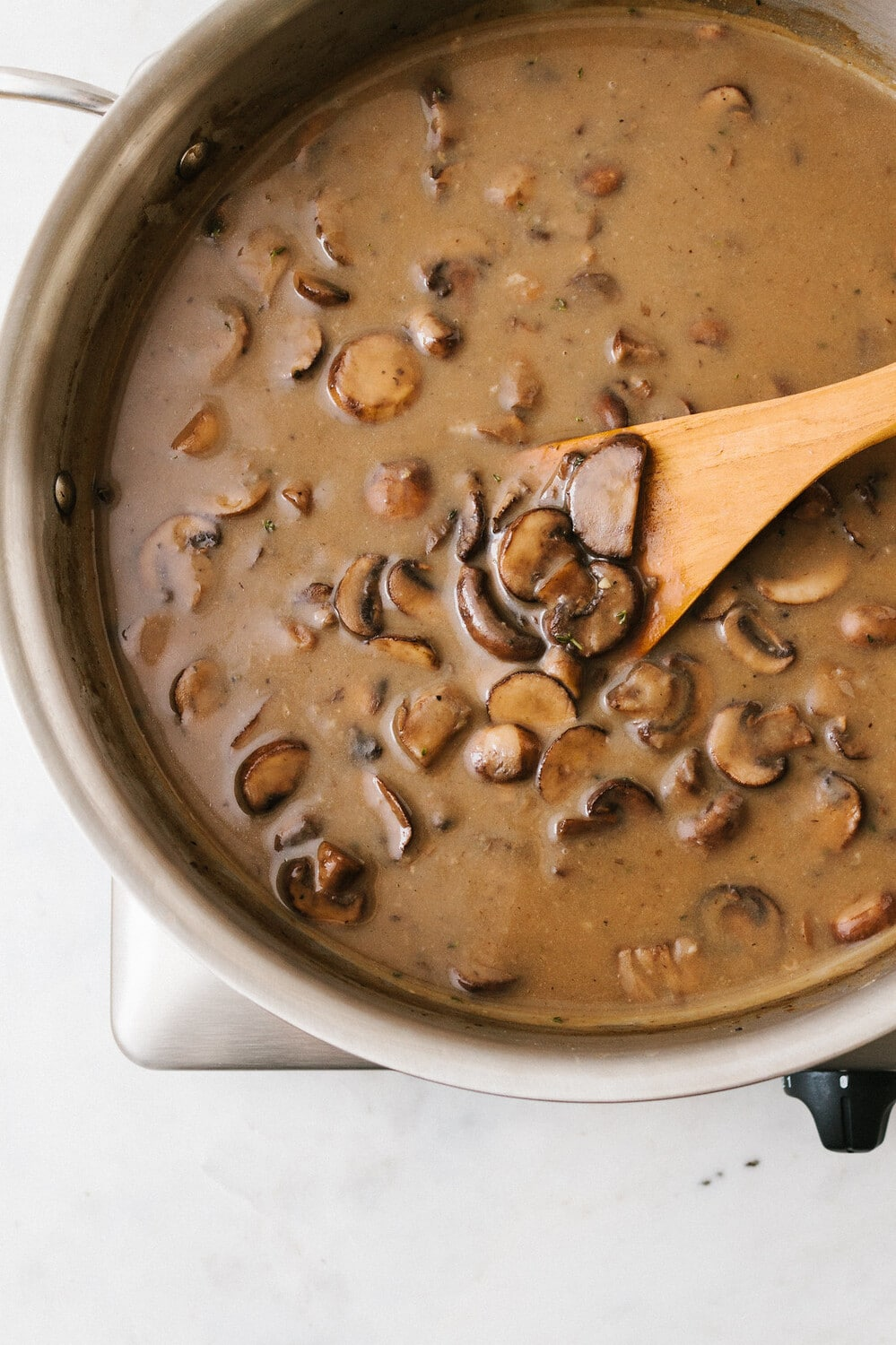 top down view of a shallow pan with freshly made vegan mushroom gravy.