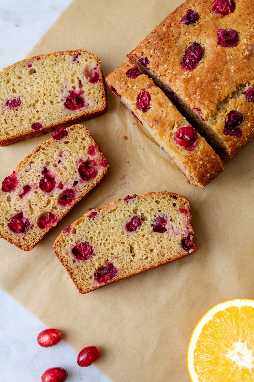 top down view of cranberry orange bread loaf, sliced