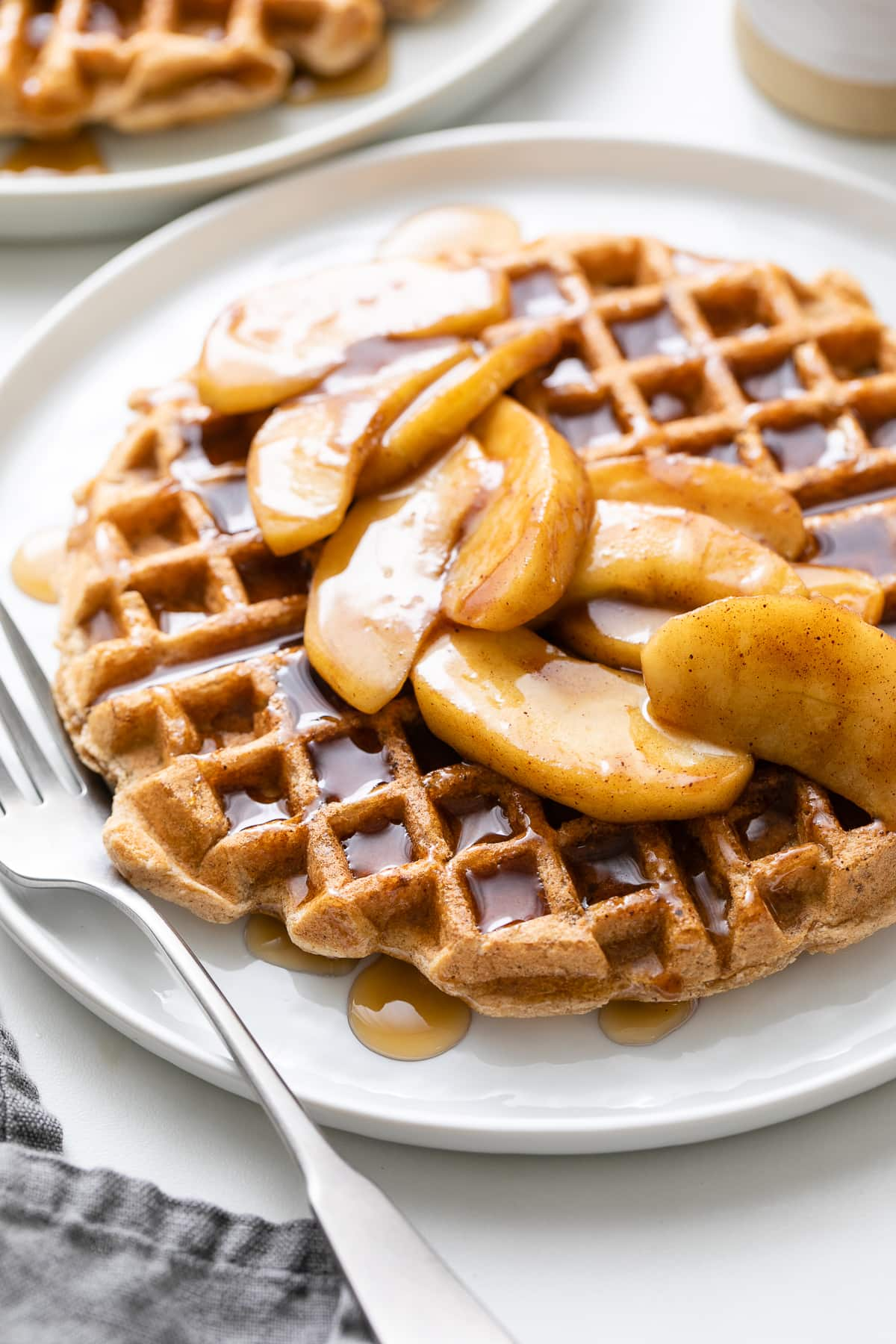 side angle view of plated cinnamon applesauce waffles.