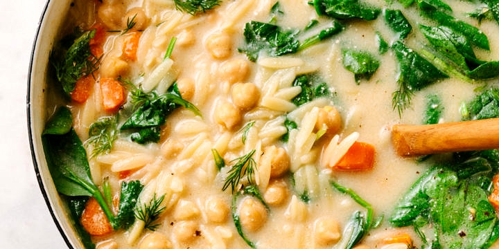 lemon chickpea orzo soup freshly cooked in a pot and ready to serve