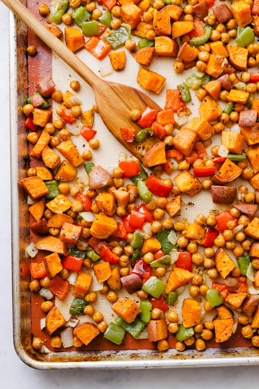 chickpea sweet potato breakfast hash on a sheet pan just pulled from the oven