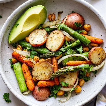 bowl with roasted asparagus, potato + chickpea with avocado