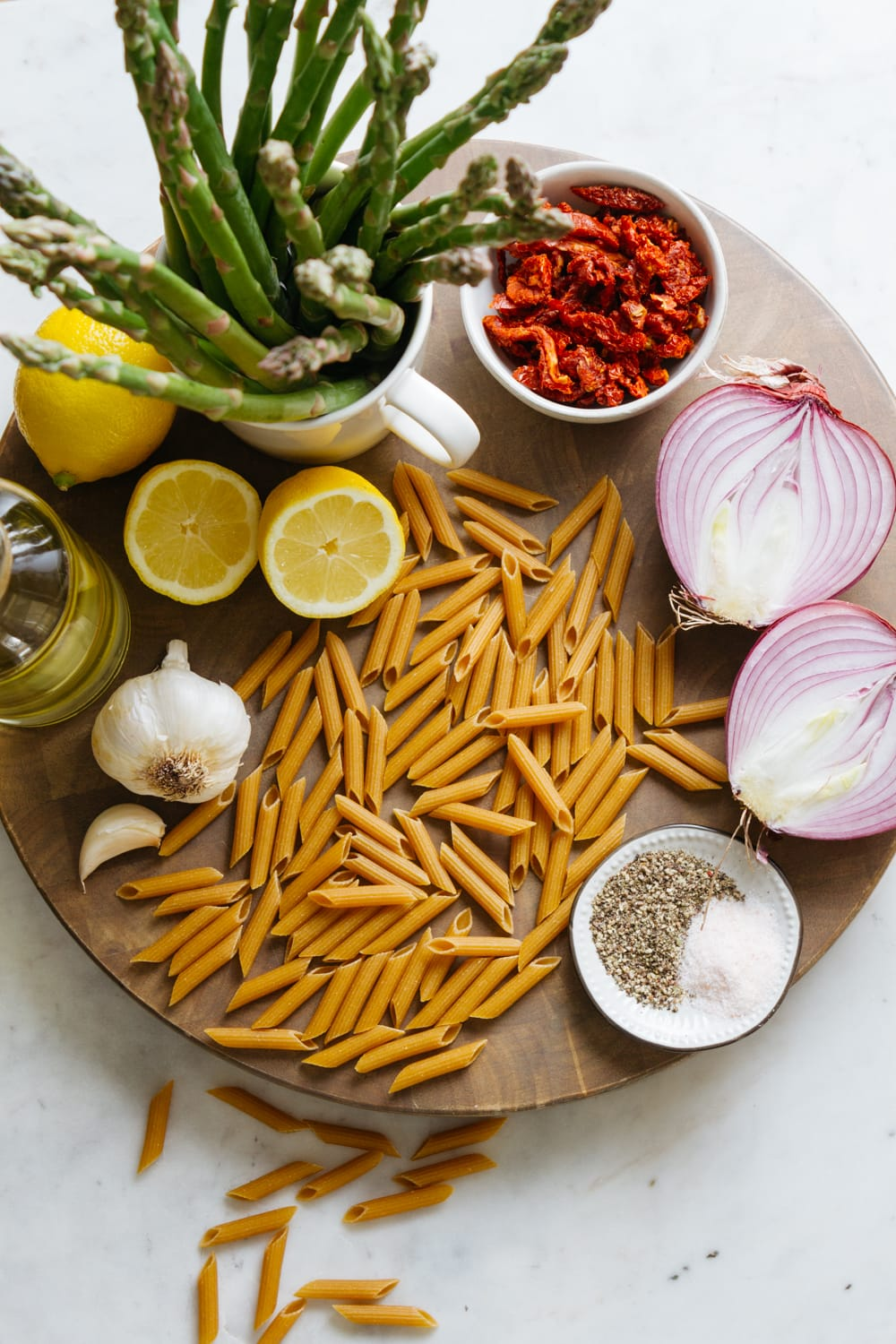 top down view of the ingredients used in lemon asparagus pasta salad