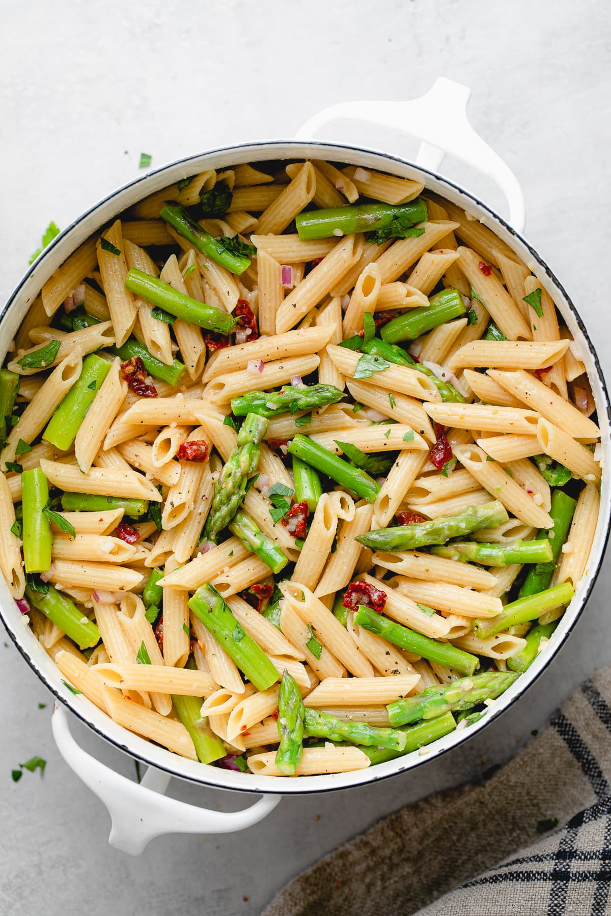 top down view of freshly made lemon asparagus pasta in a pot.