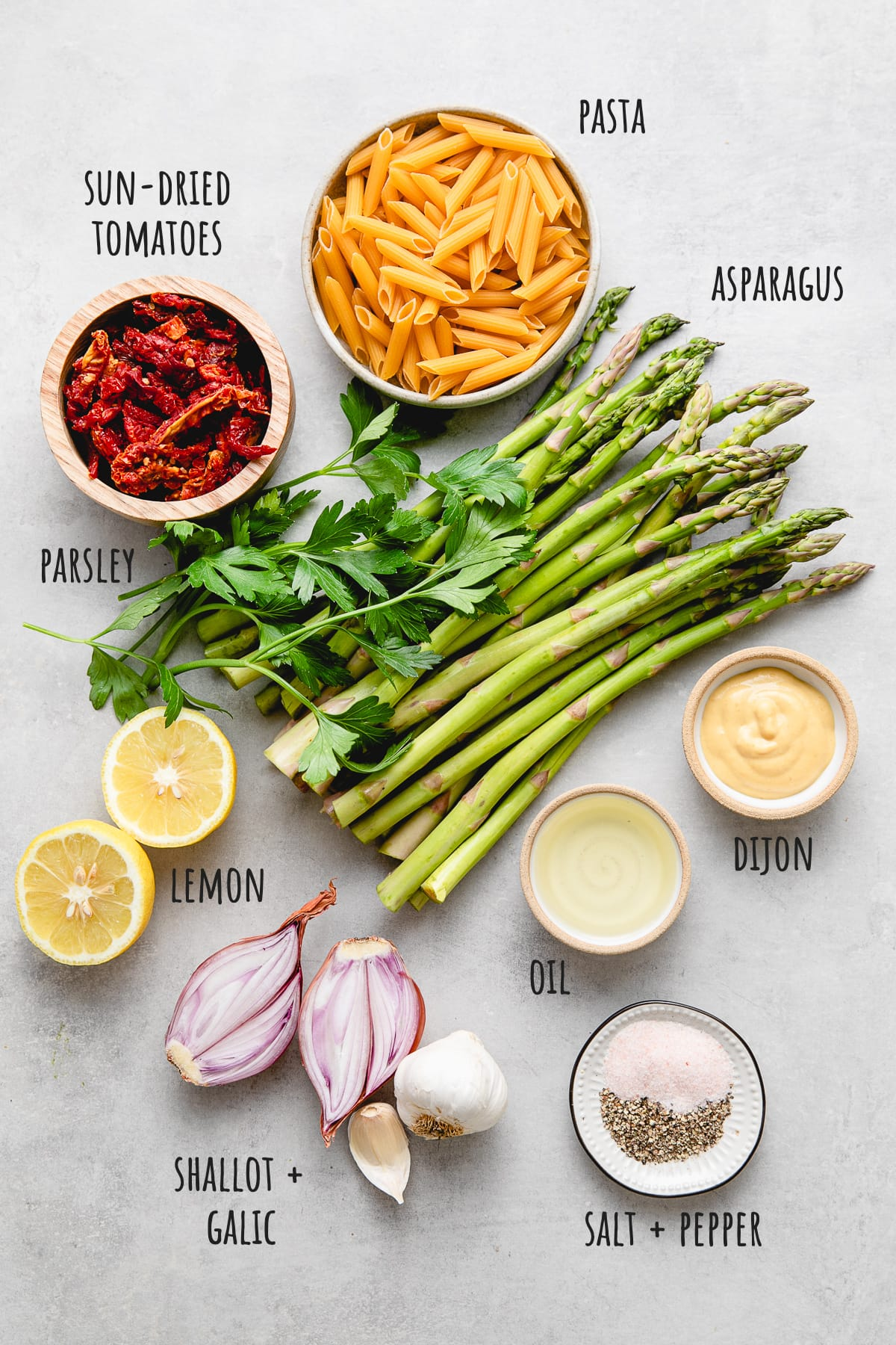 top down view of ingredients used to make asparagus pasta.