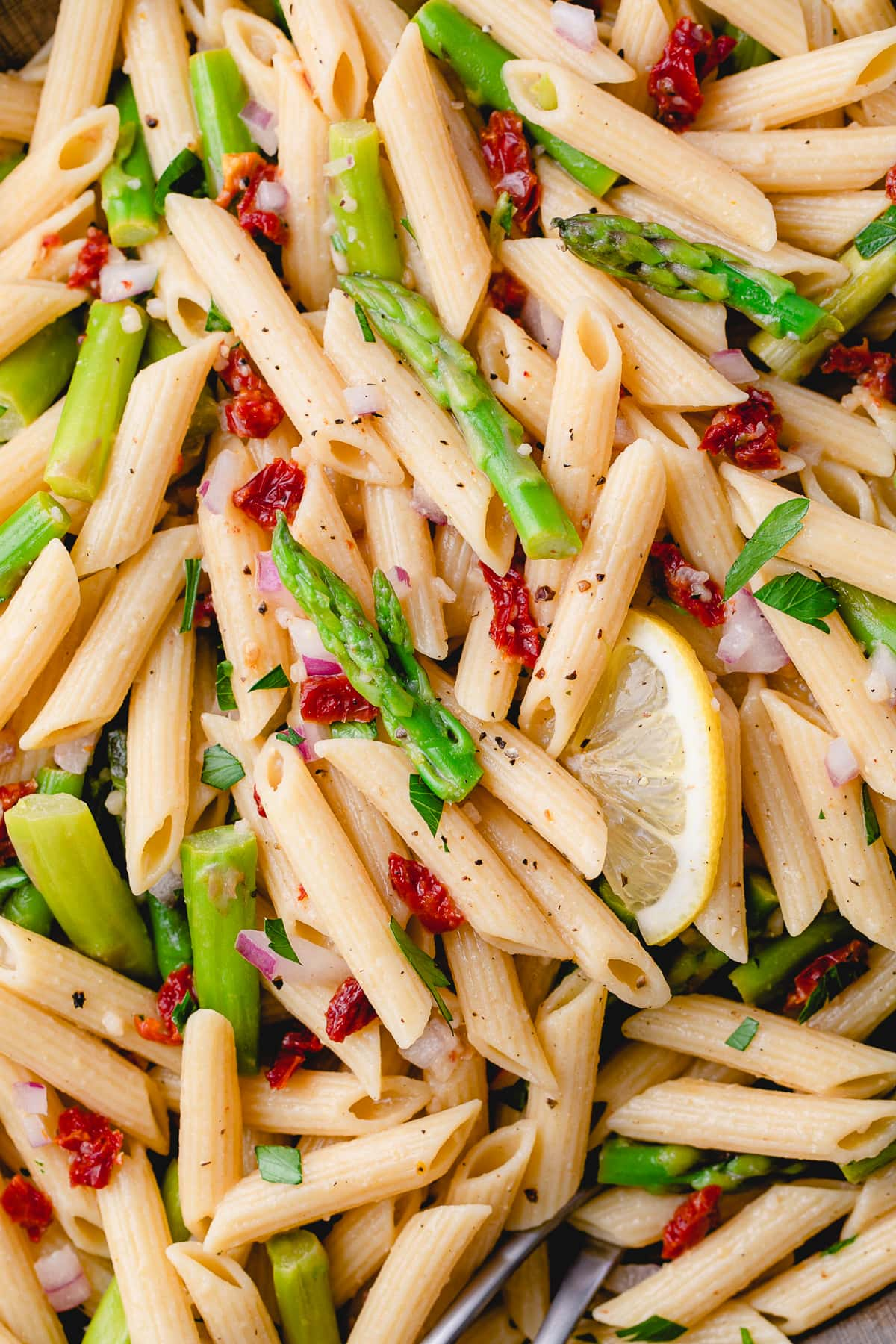 top down view of garlic lemon asparagus pasta salad.