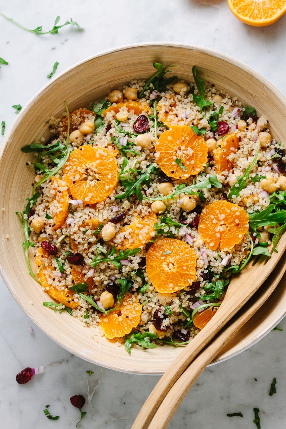 top down view of quinoa salad with orange, cranberry and mint freshly tossed and ready to serve.