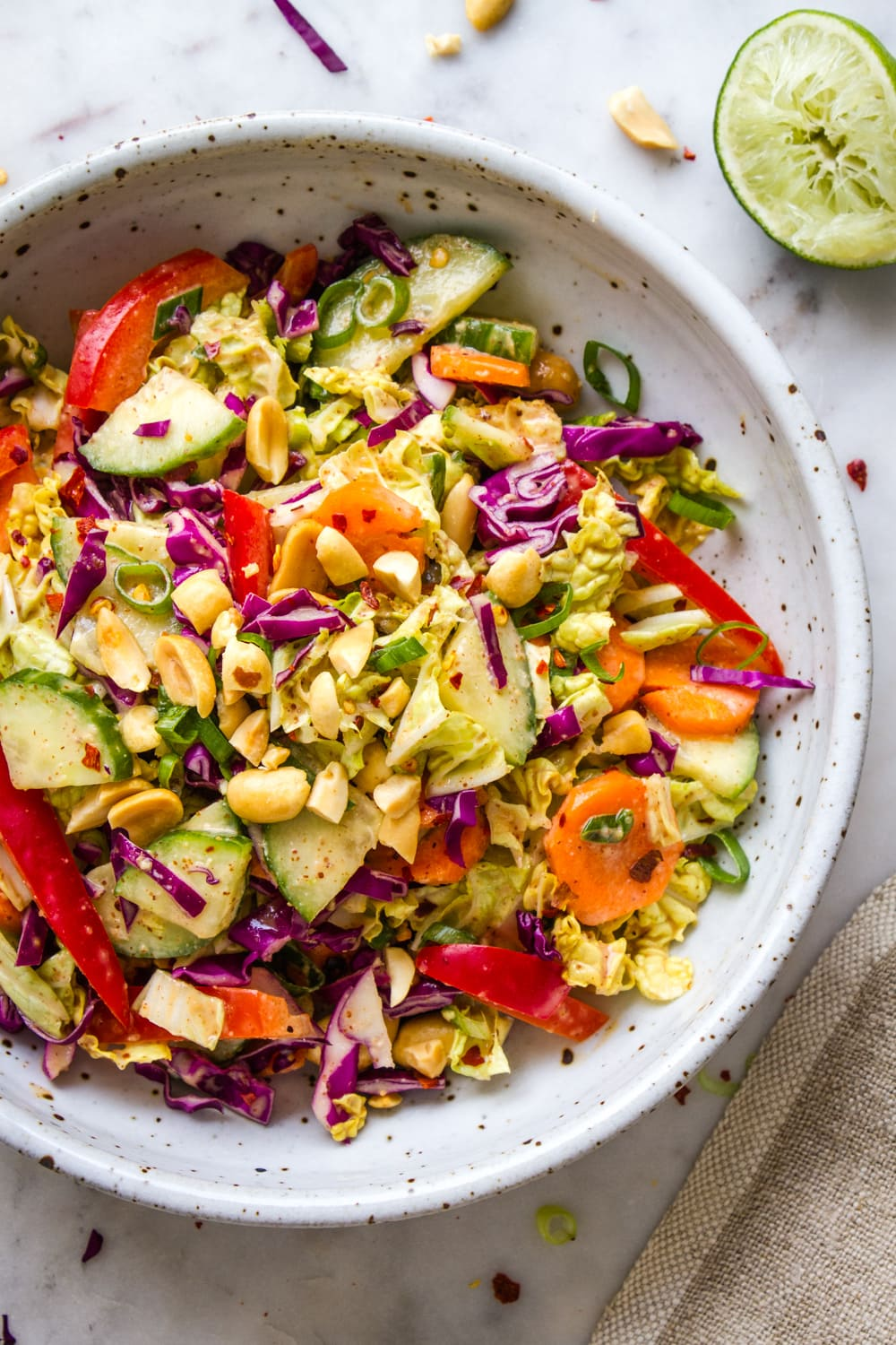 top down, up close, view of thai crunch salad served in a rustic bowl