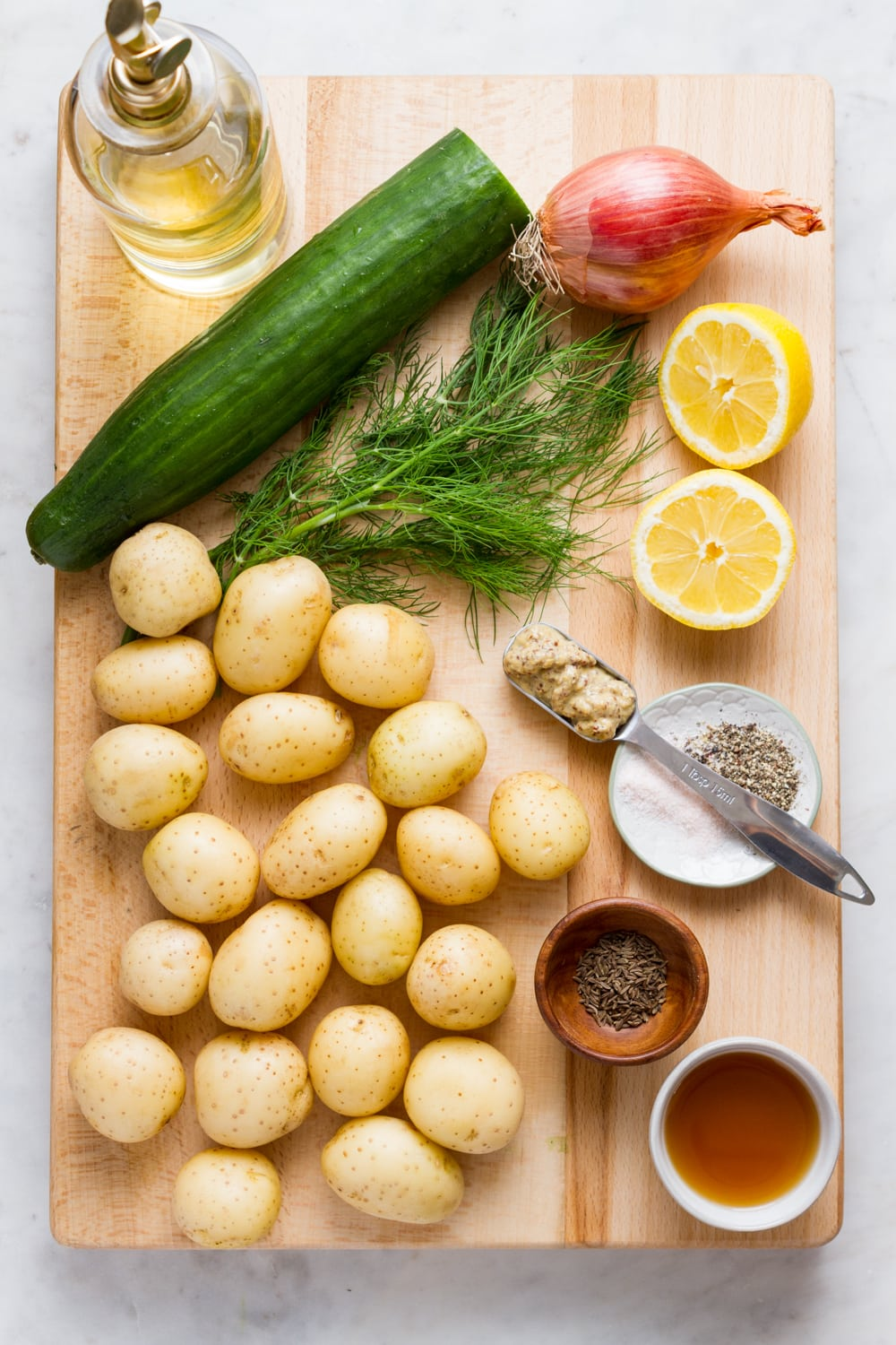 top down view of the ingredients needed to make vegan German potato salad.