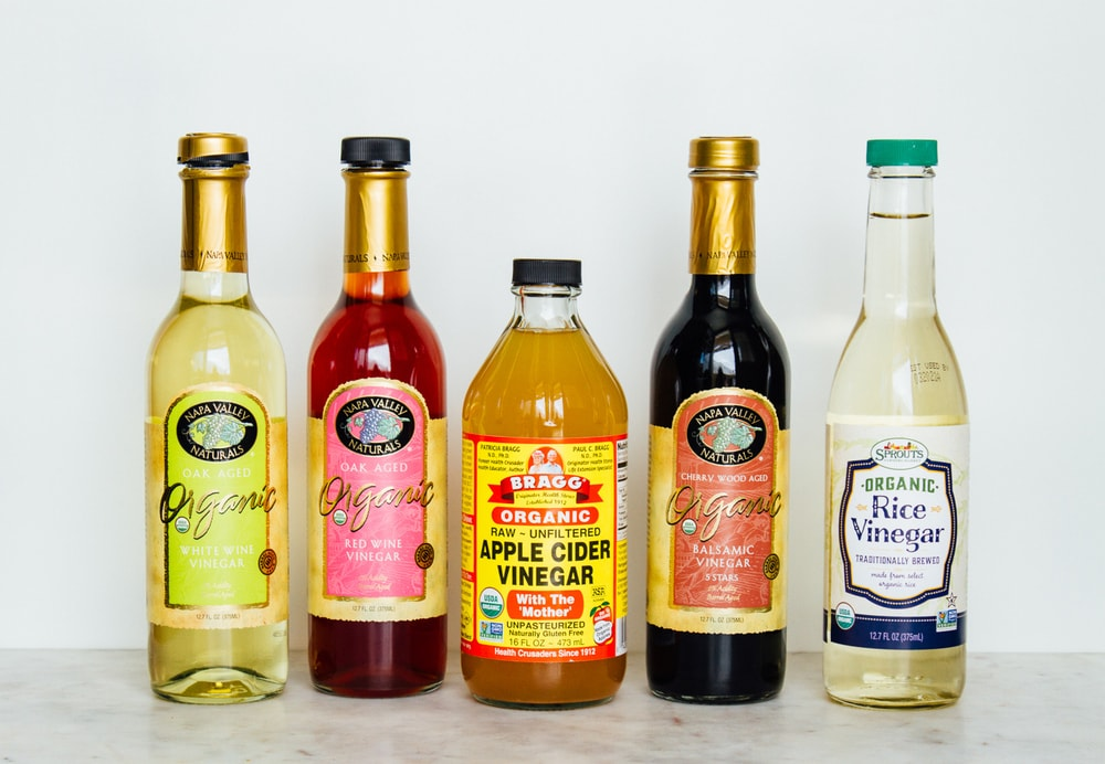 an assortment of organic vinegars for a vegan pantry.