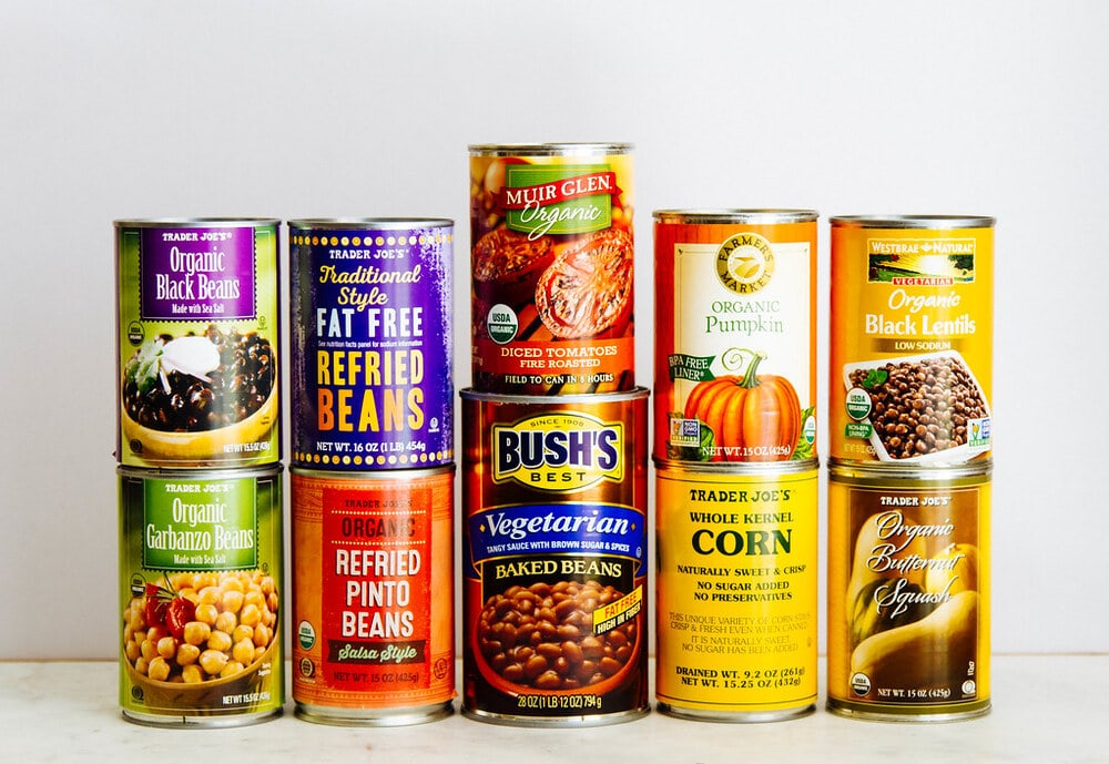 an assortment of canned goods to keep stocked for a healthy vegan pantry.