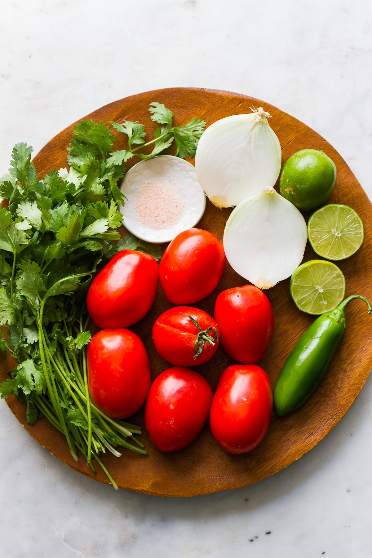 top down view of ingredients needed to make fresh pico de gallo.
