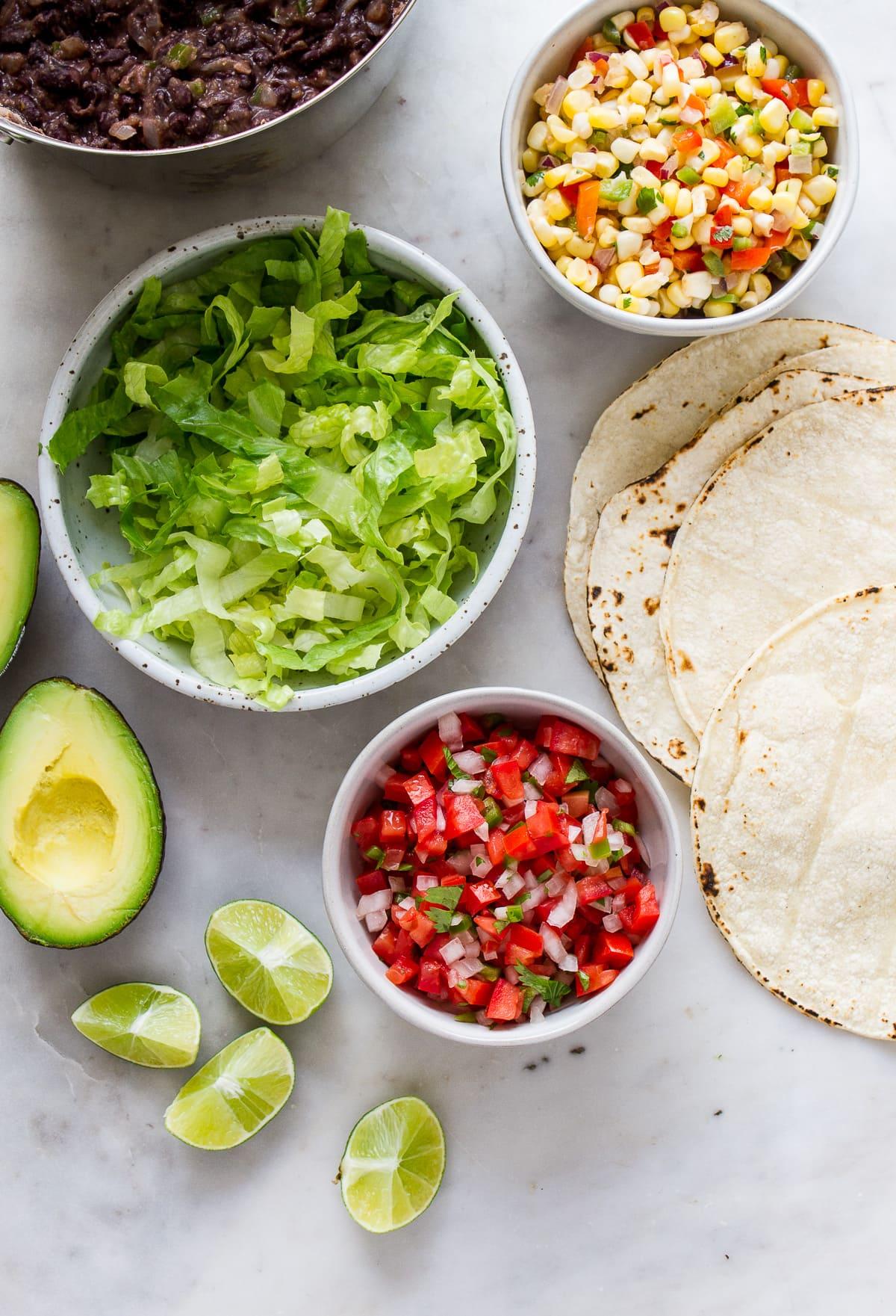top down view of ingredients for vegan black bean tacos.