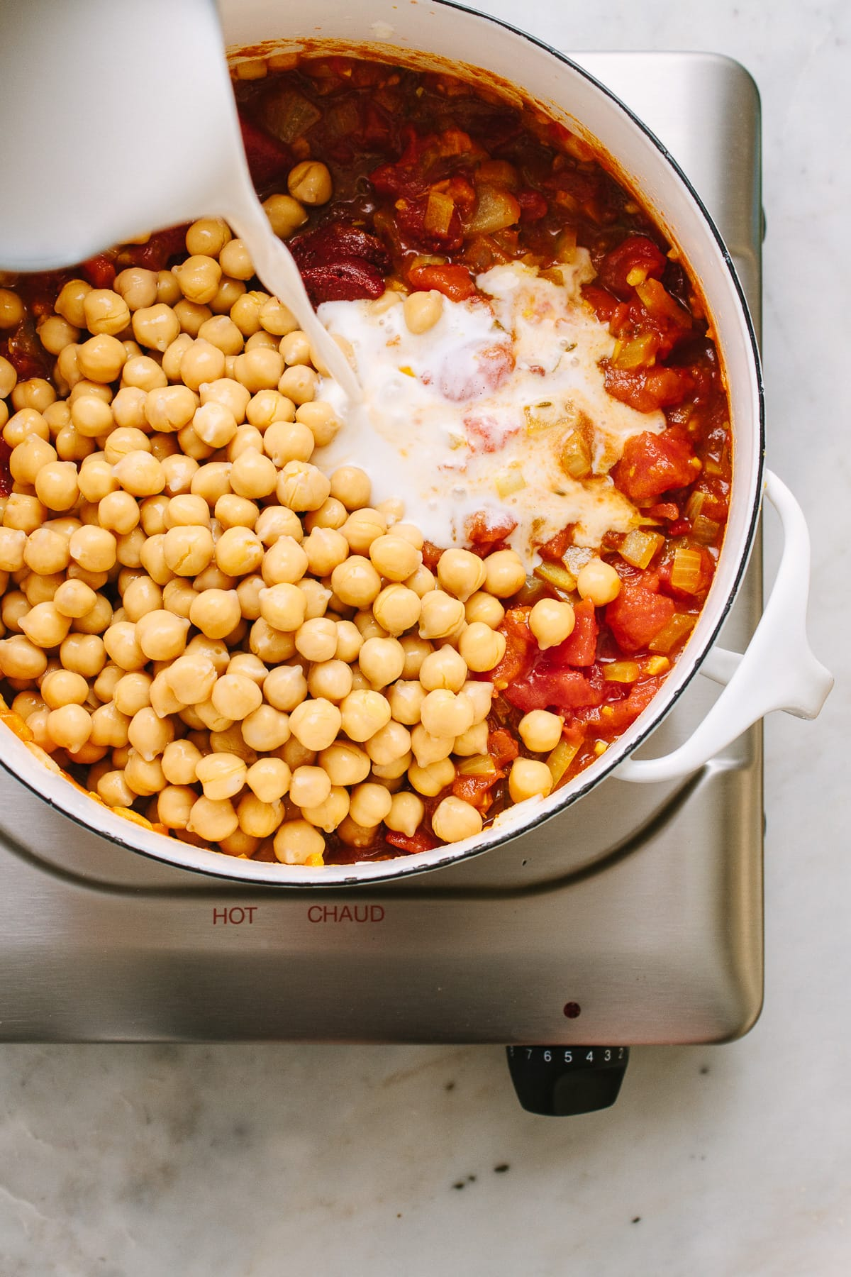top down view showing the process of making chickpea tikka masala.