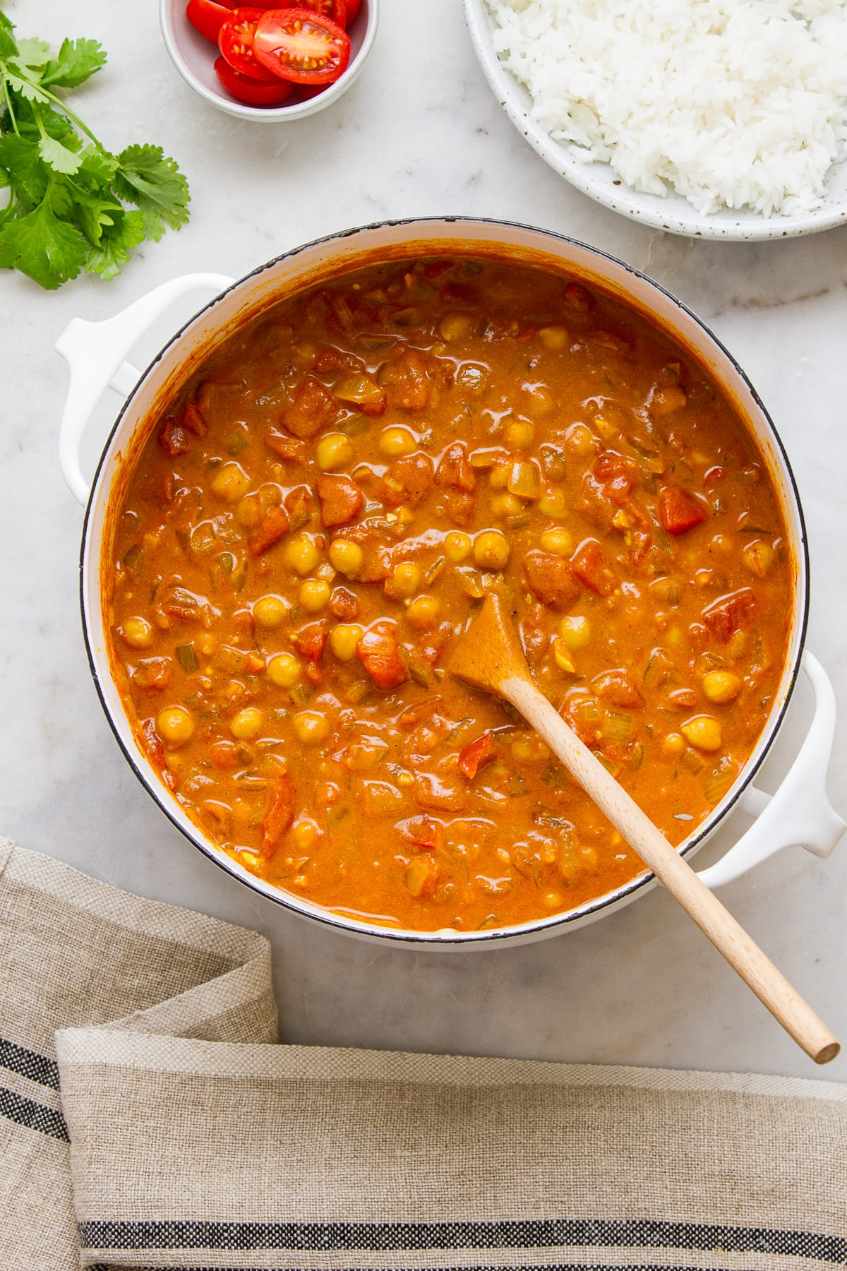top down view of a pot full of freshly made vegan chickpea tikka masala.