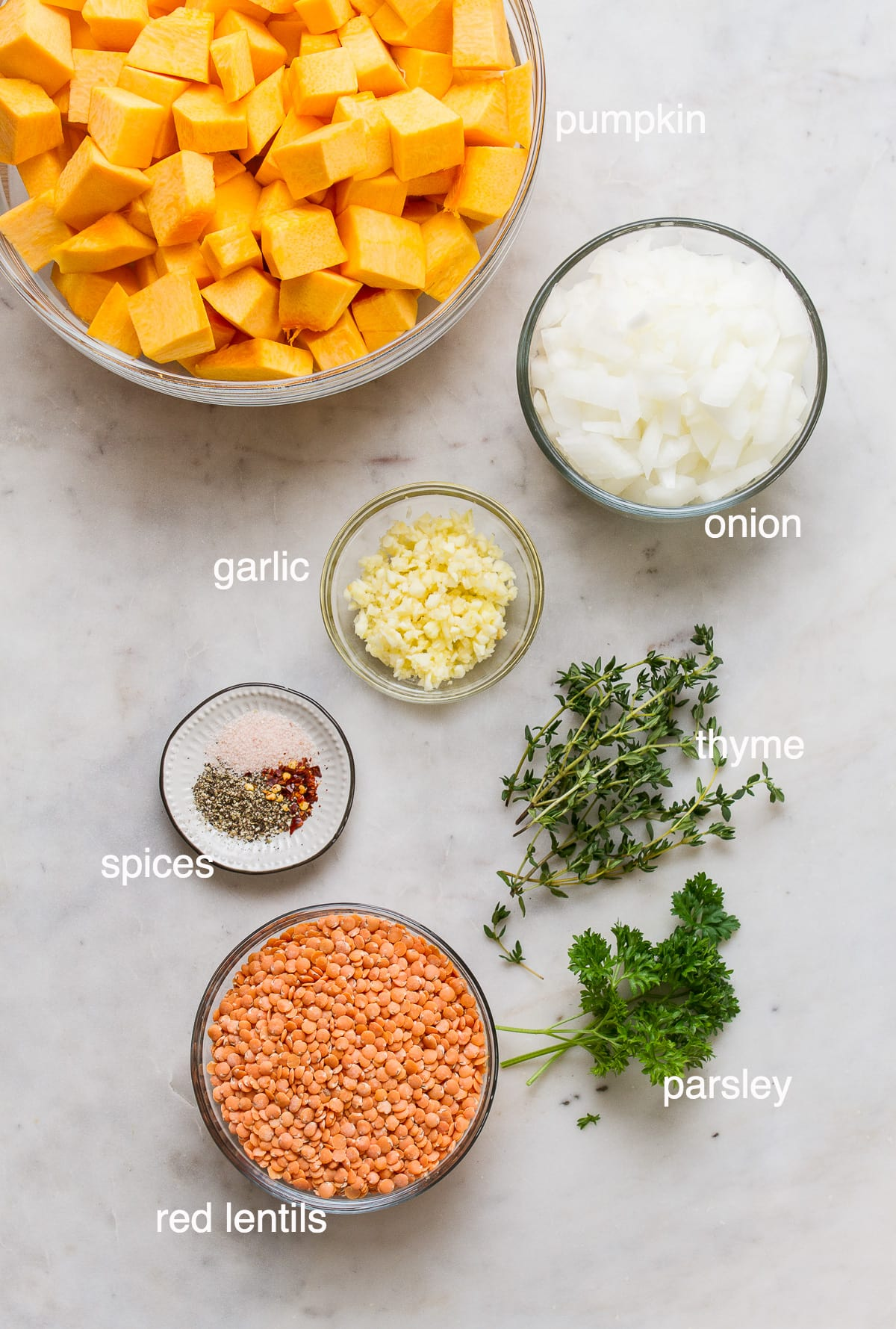 top down view of ingredients needed to make vegan pumpkin soup with red lentils.